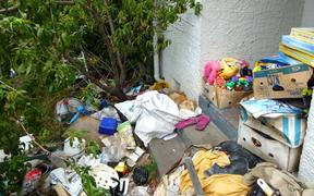 Items can be seen filling the yards of a property.