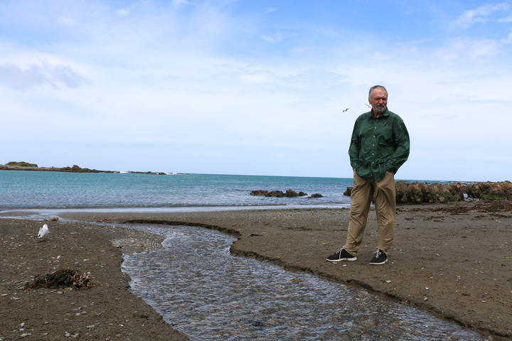 Eugene Doyle at the outlet at Ōwhiro Bay that, in recent months, has measured 30 times the level of fecal contamination considered safe to swim.