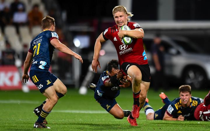Jack Goodhue of the Crusaders eludes Ash Dixon of the Highlanders during the Super Rugby match, Crusaders v Highlanders at Orangetheory Stadium, Christchurch, New Zealand, 21st February 2020.Copyright photo: John Davidson / www.photosport.nz
