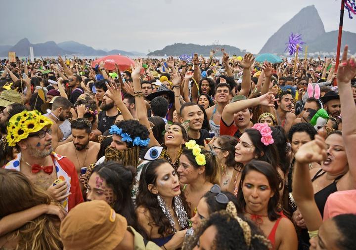 Revellers cheer during the Amigos da Onca street party in Rio de Janeiro, Brazil.