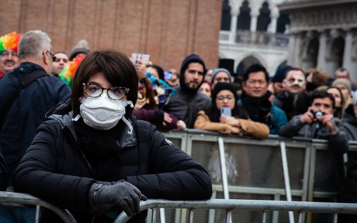 A woman wearing protective mask at the Venice Carnival, Italy, on 23 February 2020 due to concerns over coronavirus infection.