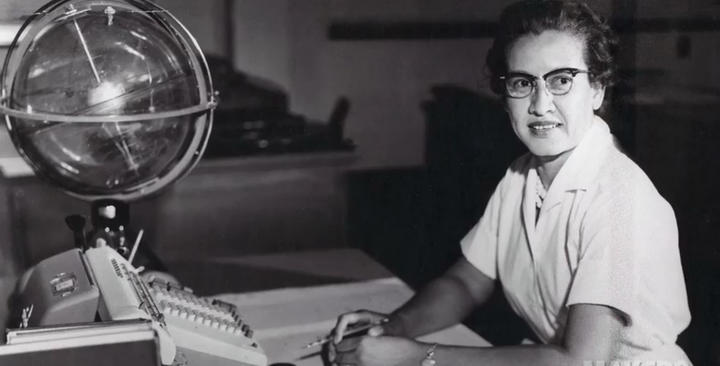 NASA file handout photo shows NASA research mathematician Katherine Johnson at her desk at Langley Research Center.