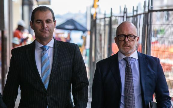 Jami-Lee Ross, left, arrives at Auckland District Court with lawyer Ron Mansfield.