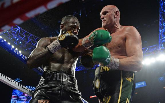 Deontay Wilder and Tyson Fury box during their WBC heavyweight title bout at MGM Grand Garden Arena. 2020.