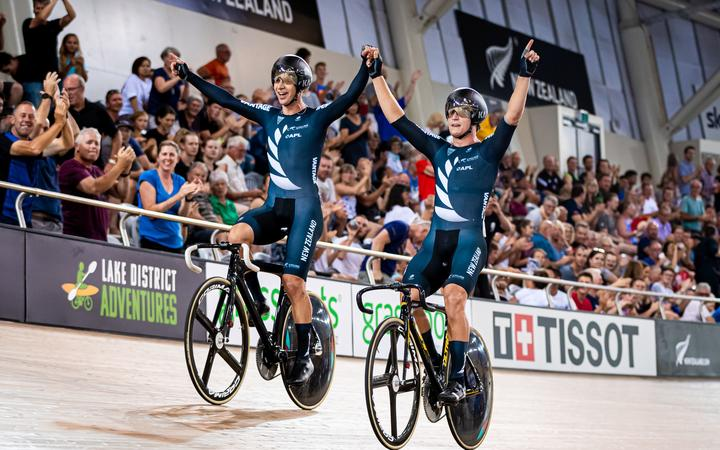 Track Cycling World Cup - Cambridge, New Zealand - Campbell Stewart and Aaron Gate of New Zealand celebrate winning Gold in the Men's Madison.