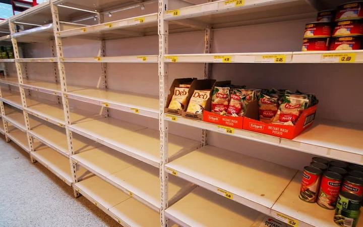 The shelves are almost empty at Foodland Supermarket due to shipping issues.