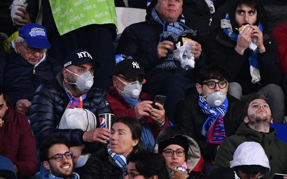 Napoli fans wearing face masks.