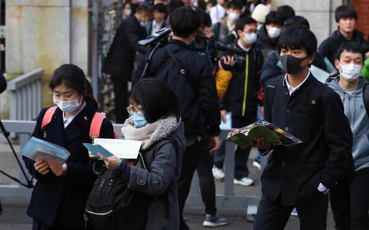 Students wearing a mask attend the second round of  the National Center Test for University Admissions at Universtiy of Tokyo in Bunkyo Ward, Tokyo on Feb. 25, 2020, amid growing fears of the coronavirus spread.