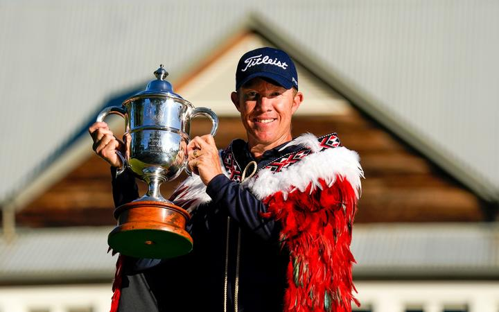 Australian golfer Brad Kennedy with the Brodie Breeze trophy after winning the 101st New Zealand Golf Open, 2020.