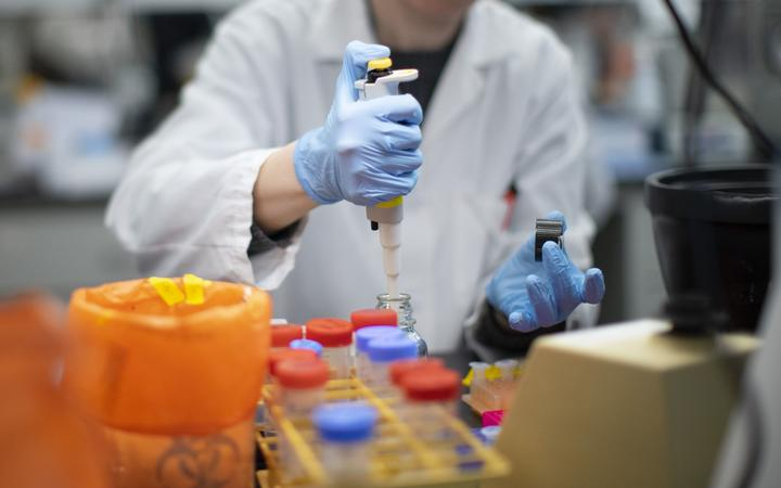 A researcher works in a lab that is developing testing for the COVID-19 coronavirus.