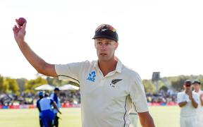 Kyle Jamieson of the Black Caps leaves the field with the match ball after getting a 5 wicket bag against India, 2020.