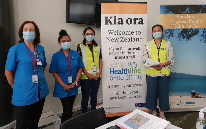 Health officials at Auckland Airport.