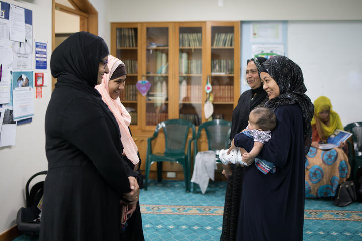 Hamimah meets Neha and cuddles baby Noor, now three months old. With Asma, Neha, and current Women's Coordinator for Al-Noor Mosque Tooba Habib.