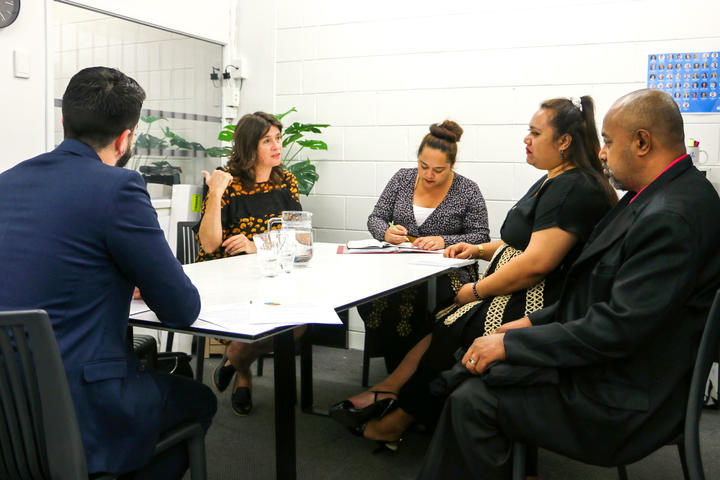 MP for Maungakiekie Denise Lee talks with Tongan parliamentary staff in her Auckland office