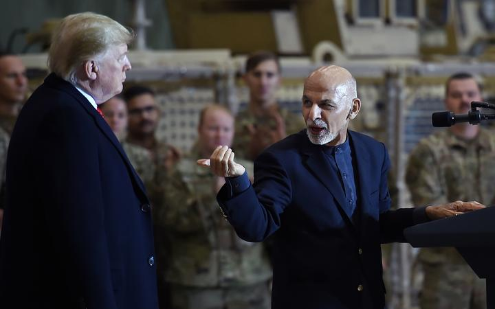 File photo taken on November 28, 2019 Afghan President Ashraf Ghani addresses US troops during a surprise Thanksgiving day visit of US President Donald Trump at Bagram Air Field,in Afghanistan.