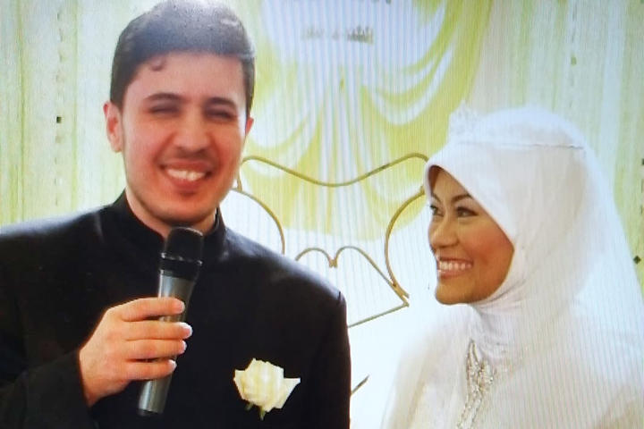 "Zekeriya and Hamimah on their wedding day in 2008. Hamimah says, ""We've lost our imam, our leader, our entertainer, our very very handyman, our favourite chef."""