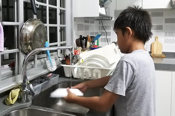Hamimah's two sons help out with the chores in their Singapore apartment.