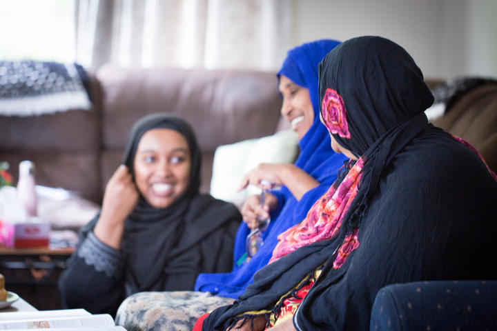 Asha, Muhubo and her mother Amina in Muhubo's new Housing New Zealand home that is large enough for the six adults in her family. Since moving out of their overcrowded house, Muhubo is happier and her health is improving.
