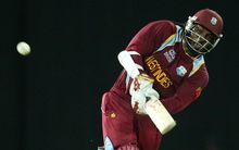 West Indies batsman Chris Gayle hits a six.