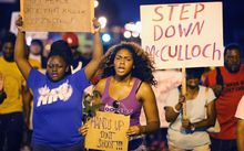 Demonstrators protest the death of Michael Brown on 21 August 2014 in Ferguson, Missouri.