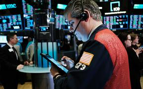 Traders work on the floor of the New York Stock Exchange (NYSE) on March 03, 2020 in New York City. stocks one again fell on Wall Street as global concerns over the financial impact from the Coronavirus drive investments down.