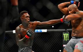 Mar 7, 2020; Las Vegas, Nevada, USA; Israel Adesanya (red gloves) fights Yoel Romero (blue gloves) during UFC 248 at T-Mobile Arena. Mandatory Credit: Stephen R. Sylvanie-USA TODAY Sports