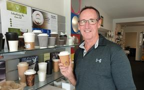 Glopac general manager Chris Thomson with one of the plastic-free coffee cups.