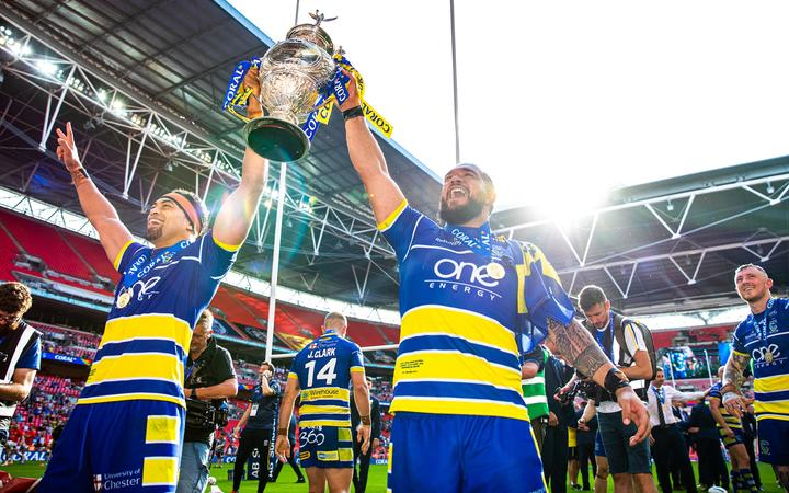 Sitaleki Akauola and Ben Murdoch-Masila celebrate Warrington's Challenge Cup final victory over St Helens in August.