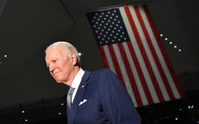 Democratic presidential hopeful former Vice President Joe Biden walks out after speaking at the National Constitution Center in Philadelphia.