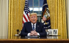 US President Donald Trump addresses the Nation from the Oval Office about the widening novel coronavirus (Covid-19) crisis in Washington, DC on March 11, 2020.