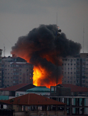 A ball of fire rises from a building after an Israeli air strike in Gaza City.