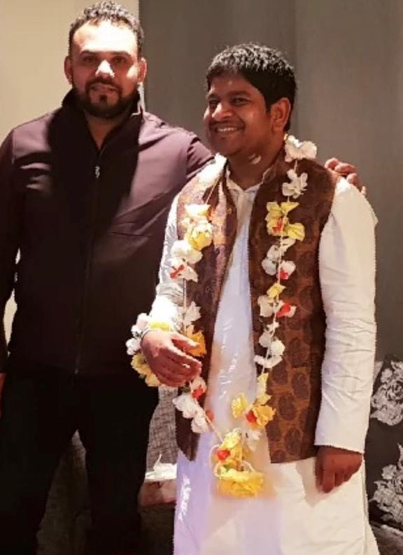Mohammad Khaja Mohiuddin with his friend, Imran Khan (left), who was killed in the attack on Christchurch mosques last year.