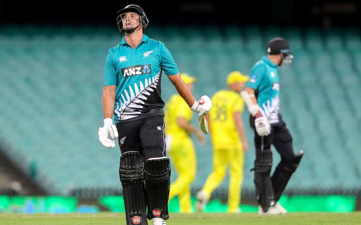 Black Caps all-rounder Colin de Grandhomme walks off an empty SCG after being dismissed.