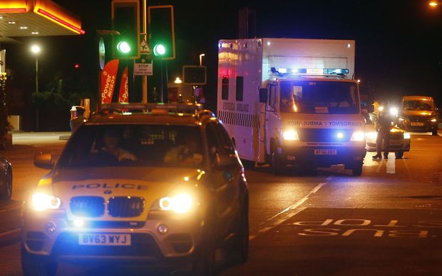 Police escort an RAF ambulance carrying a British man infected with the Ebola virus at Northolt air base outside London.