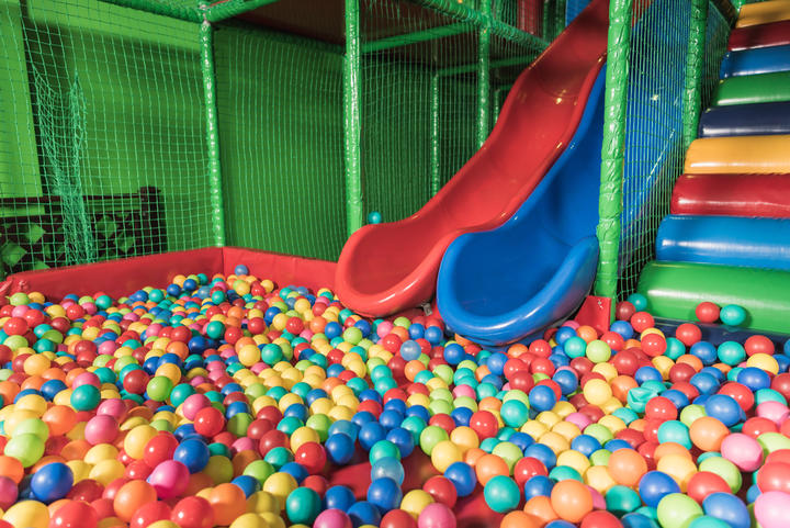 slides and pool with colorful balls in entertainment center