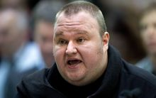 Kim Dotcom is fighting a ruling that warrants used in the raid on his mansion were valid.
