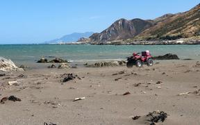 Garry and Mandy Ham drove their quad bikes out to Ward Beach and were told off.