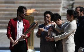 The Olympic Flame is handed over officially to the  congregation from Japan, 2020.