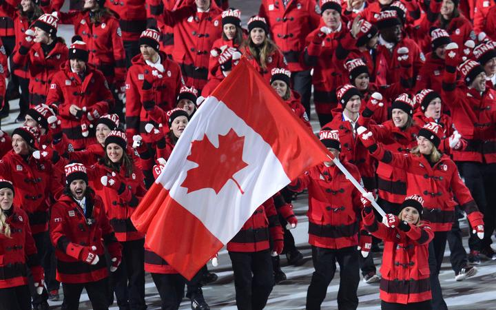 The Canadian flag bearer at the 2014 Winter Olympics.