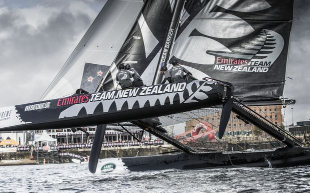 Team New Zealand competing on the final day of racing in the Extreme Sailing Series on Cardiff Bay.