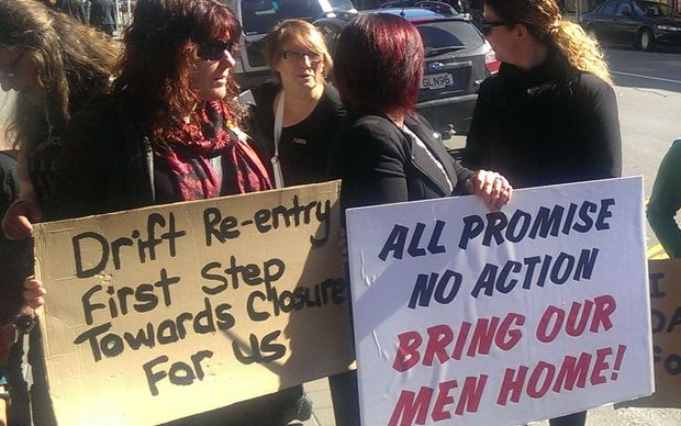 Relatives of Pike River victims protesting against Mr Key's visit.