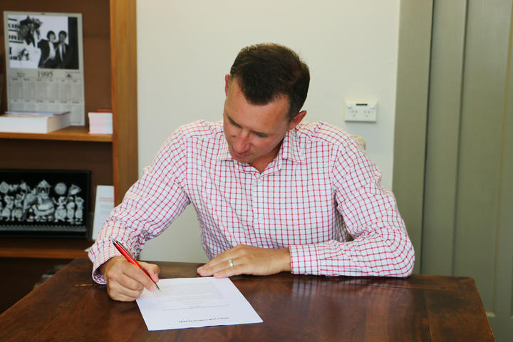 Labour list MP Jamie Strange examines his member's bill in his Hamilton office.