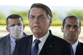 President Jair Bolsonaro (centre) maintains that Brazilians must keep working while taking precautions not to catch Covid-19.