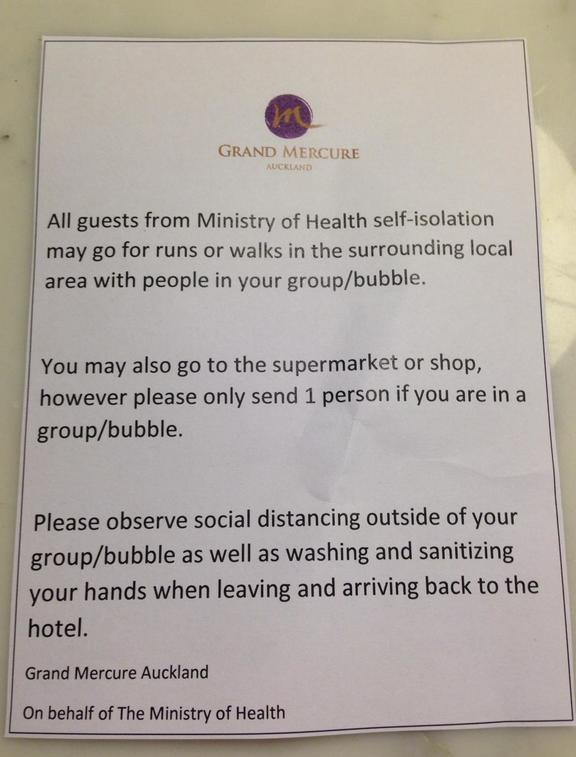A note from the Grand Mercure hotel in Auckland, on behalf of the Ministry of Health, telling those quarantined in the hotel they can go for walks etc outside.