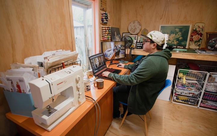 Claire Eastham-Farrelly working from her partner's sewing shed during the Covid-19 lockdown.