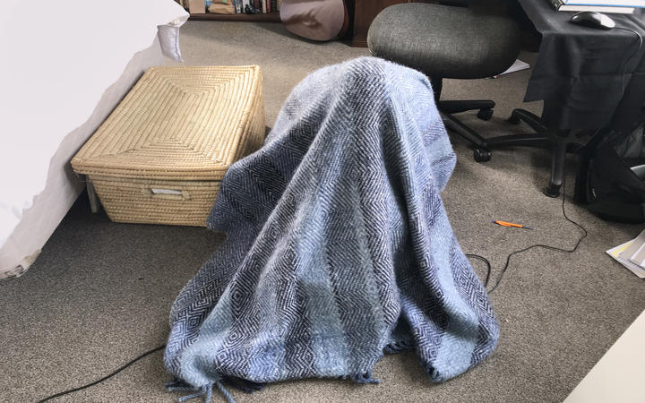Kate Newton records under a blanket during the Covid-19 lockdown.