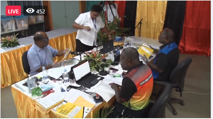 An action shot of election officials counting Vanuatu's election results.