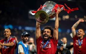 Mohamed Salah of Liverpool celebrates with the UEFA Champions League trophy