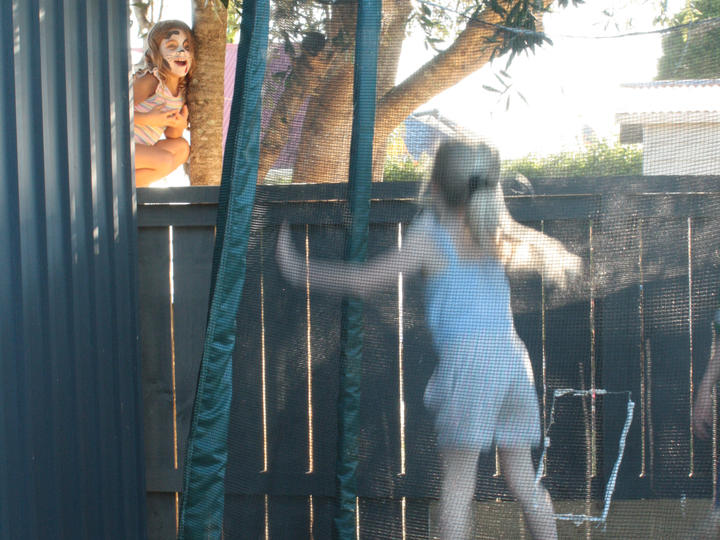 Isabel, 6, and Eve, 5, catch up over the fence