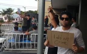 Refugees protest at their Brisbane hotel.